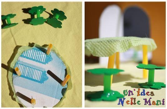 casa delle bambole faidate con scatola di cartone e cannucce