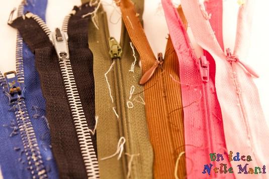 riciclo indumenti e abiti vecchi e cerniere