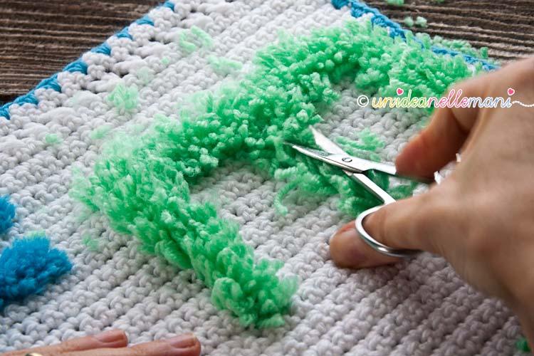 ricamo lettere, ricamo su maglia, ricamo lana,