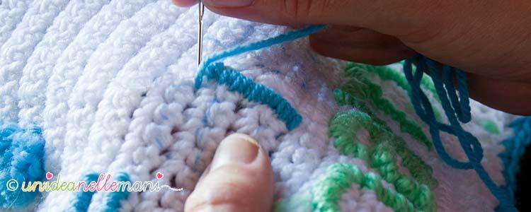 ricamare lettere, ricamo su maglia, ricamo su lana,
